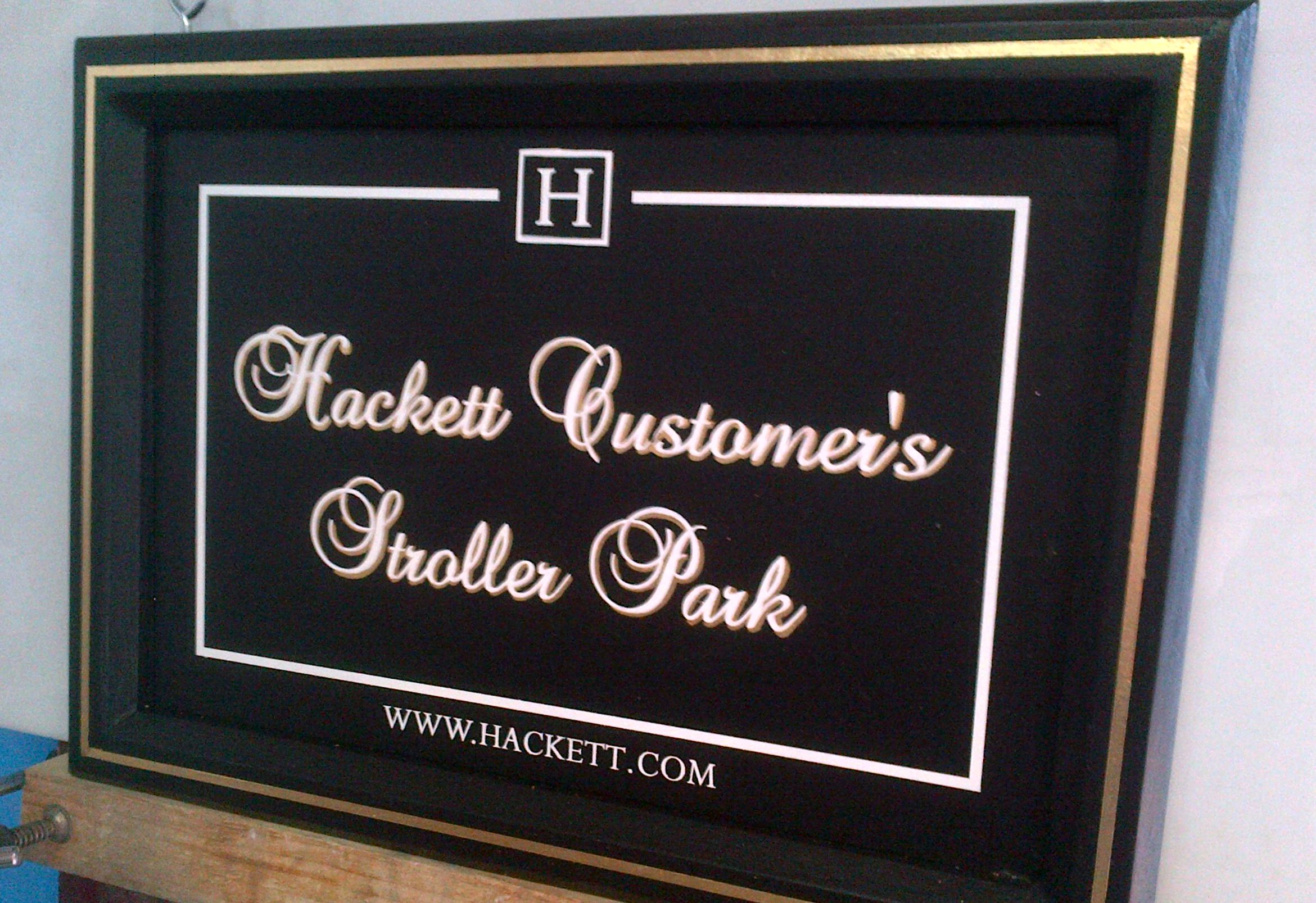 Painted wooden sign with gold leaf lettering