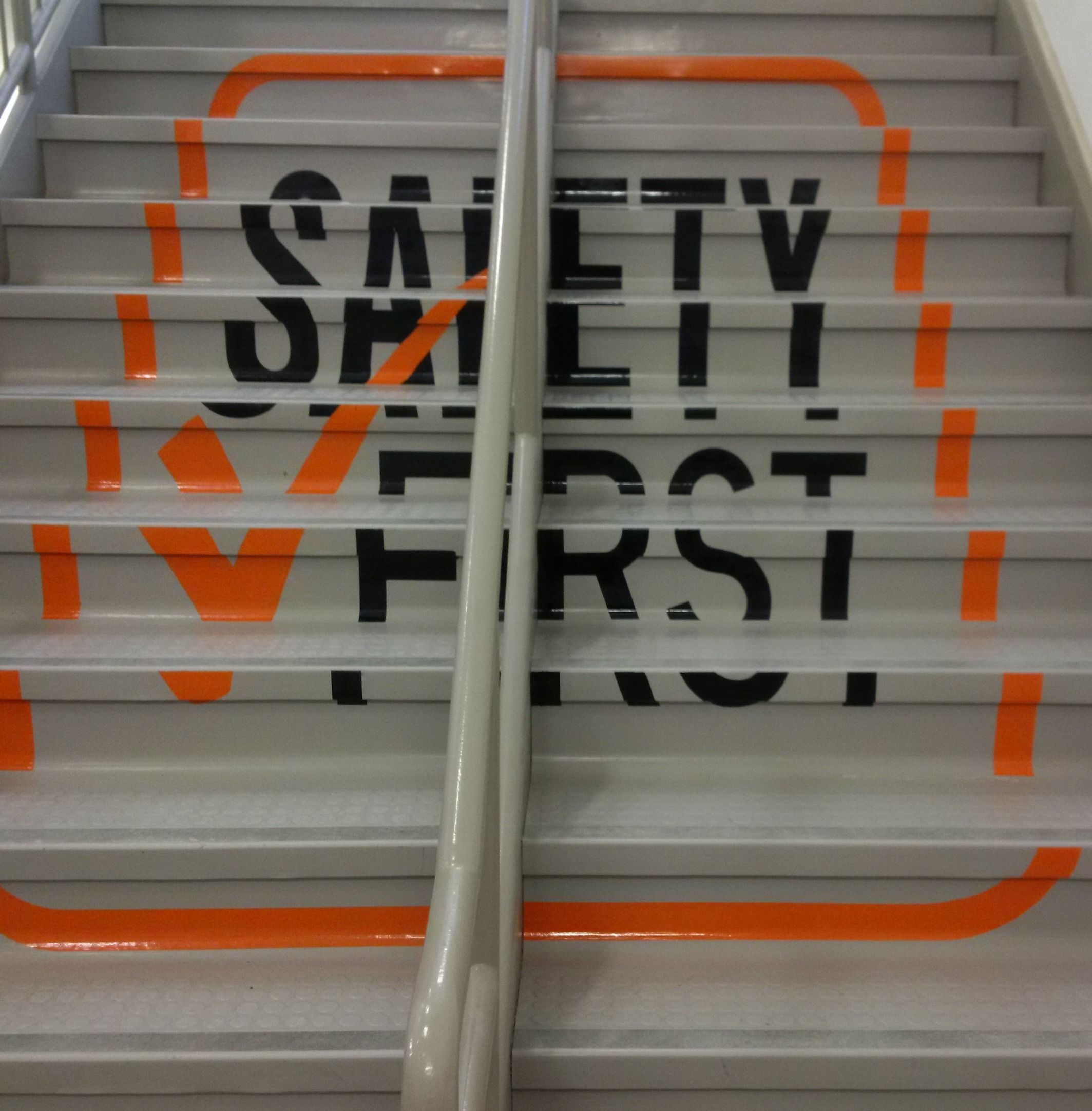 Hand-painted safety message on stairs