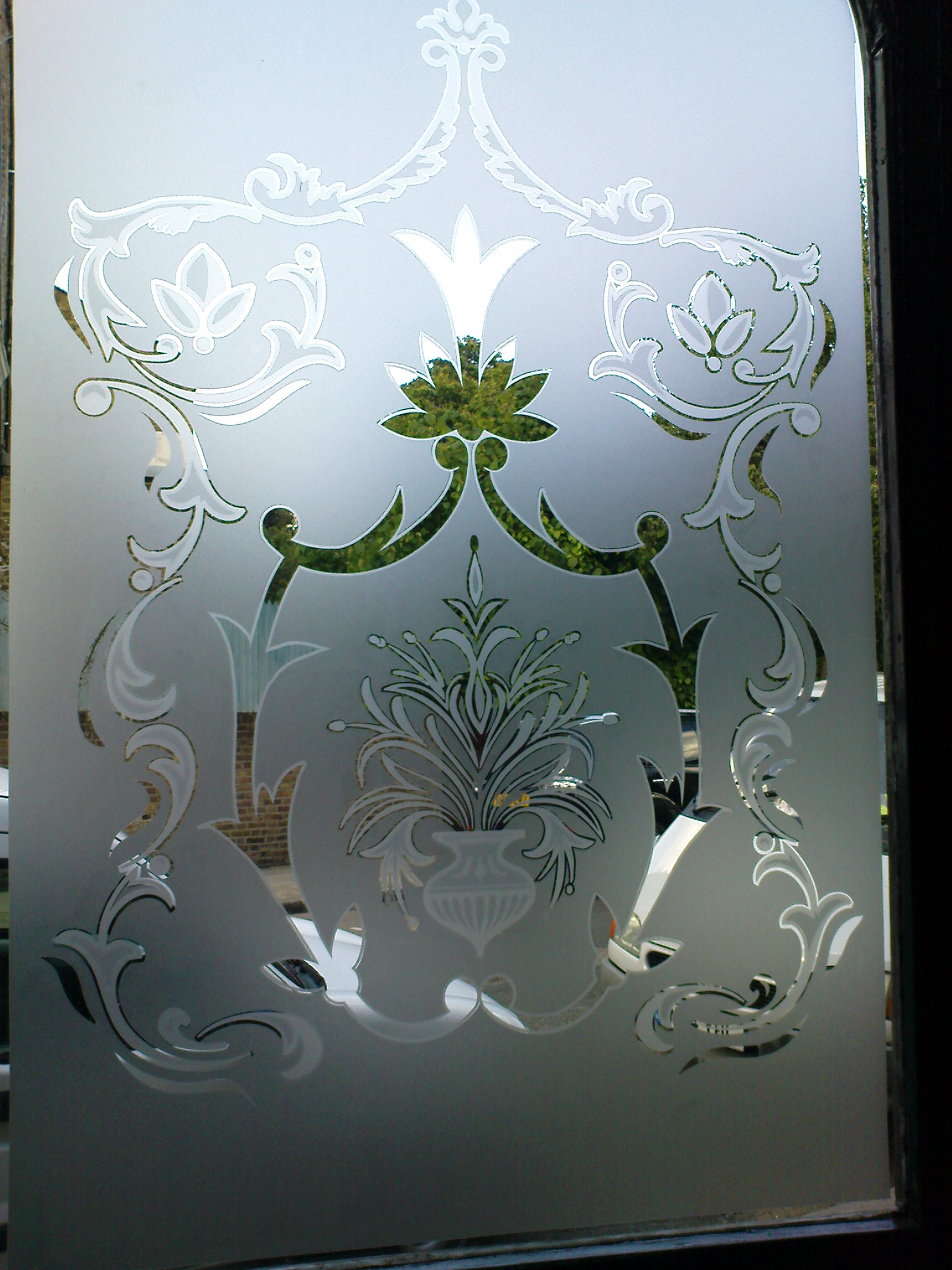 Etched glass design on pub door