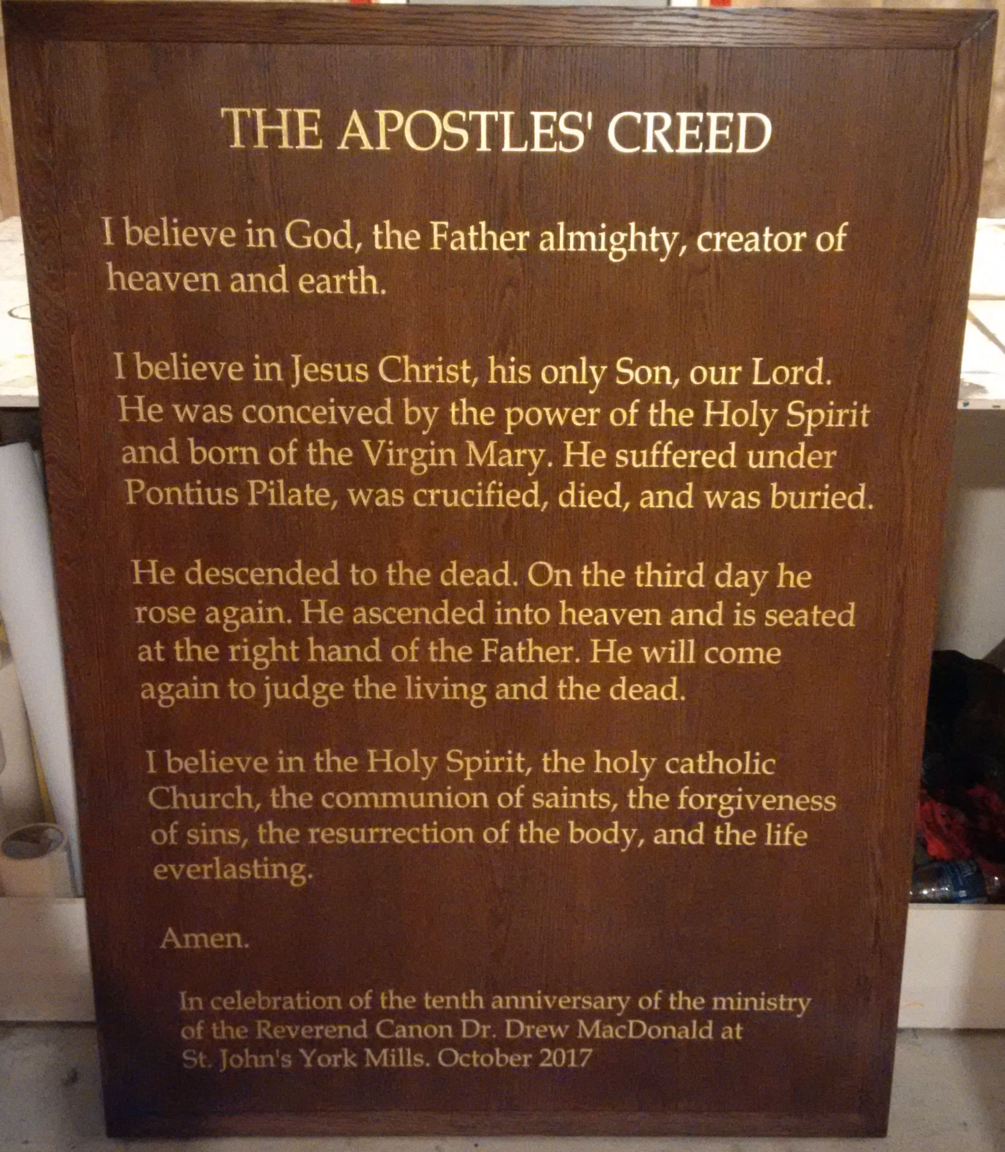 The Apostles Creed in gold leaf on polished wooden sign