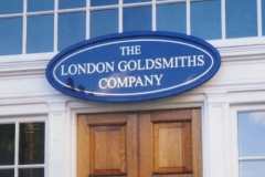 Gilded lettering on glass with wooden framed sign. Pall Mall, London 2000