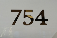 Gilded number on glass with black outline