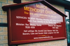 Wooden painted church sign with hand-painted lettering. London 2001