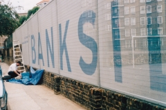 Hand-painted lettering onto chain-link fence at Bankside, London 1999