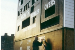 Vic hand-painting the old scoreboard at the Oval Cricket Ground, London 1998