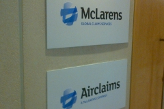 Acrylic signs with vinyl lettering and printed logos